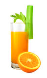 Orange juice and celery. Juice and half of orange decorated with celery on white Royalty Free Stock Photography