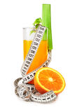 Orange juice celery and measure tape. Diet concept isolated on white Royalty Free Stock Images