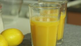 Prange juice for chocolate mousse with orange jelly. Orange juice for chocolate mousse with orange jelly in the kitchen stock video footage