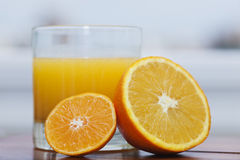 Orange juice and citrus fruits. A glass with some orange juice, an orange and a tangerine Stock Photo