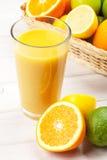 Orange juice and citrus fruits Royalty Free Stock Photos