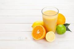 Orange juice and citrus fruits Royalty Free Stock Photo