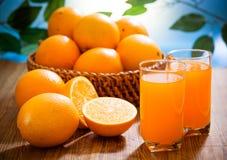 Orange juice. Closeup of sliced orange juice and fruits stock photography