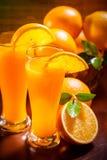 Orange juice. Closeup of sliced orange juice and fruits royalty free stock photo
