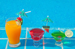 Orange juice and Cocktails near the swimming pool Stock Image