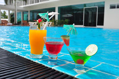 Orange juice and Cocktails near the swimming pool Royalty Free Stock Photography