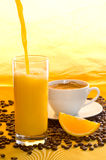 Orange juice, coffee grains Stock Photo