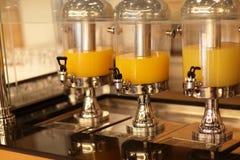 Orange juice in container Stock Photos