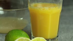 Orange juice for cooking chocolate mousse with orange jelly dessert. On table in the kitchen closeup stock video