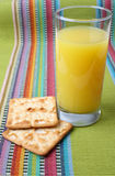 Orange Juice and Crackers Stock Image