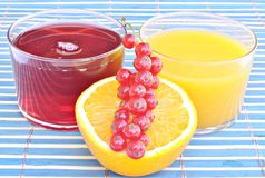 Orange juice with cranberry juice Stock Photos