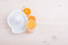 Orange juice beside delicious ripe oranges on the table. Orange juice beside delicious ripe oranges  the table Stock Photos