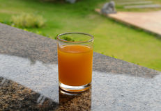 Orange juice on dining table Royalty Free Stock Photography