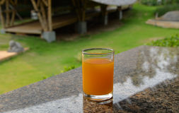 Orange juice on dining table Stock Photos