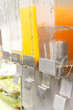 Orange juice in dispenser Stock Photos