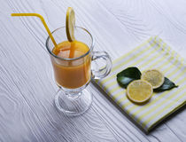 Orange juice, drinking straw yellow, lemon slices Royalty Free Stock Photography