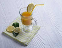 Orange juice, drinking straw yellow, lemon slices Stock Photography