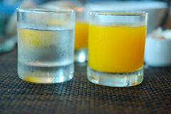 Orange juice and drinking water. Orange juice and drinking water on breakfast time Royalty Free Stock Images
