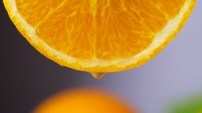 Orange juice dropping from orange slice in slow motion, Close-up fruit for diet. And healthy food stock video