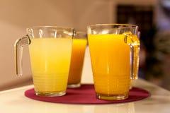 Orange juice. Few fresh orange juice on red dish Stock Images