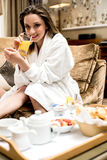 Orange juice finest healthy drink. Young woman drinking glass of orange juice Royalty Free Stock Photos