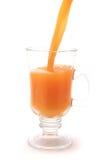Orange juice flow Stock Image