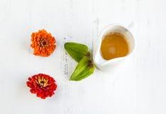 Orange juice with flowers Royalty Free Stock Image