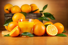 Orange juice with fresh fruits royalty free stock photography