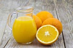 Orange juice and fresh fruits Stock Photography