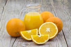 Orange juice and fresh fruits Royalty Free Stock Photos