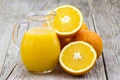 Orange juice and fresh fruits Stock Photos
