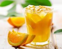 Orange juice  with  fresh fruits on  wooden background Royalty Free Stock Photography