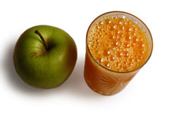 Orange juice and fresh green apple Stock Photos