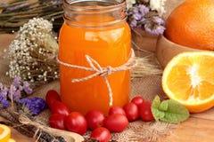 Orange juice with fresh orange fruits sliced. Stock Photography