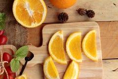 Orange juice with fresh orange fruits sliced. Stock Photos