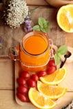 Orange juice with fresh orange fruits sliced. Royalty Free Stock Photos