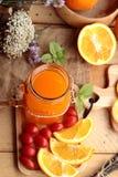 Orange juice with fresh orange fruits sliced. Stock Images
