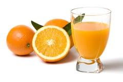 Orange juice and fresh oranges royalty free stock photo