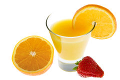 Orange juice with fresh oranges and strawberry Stock Image