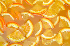 Orange juice. Fresh slices orange juice background Stock Images