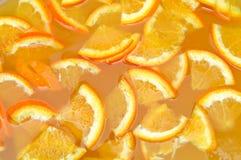 Orange juice. Fresh slices orange juice background Royalty Free Stock Photography