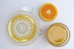 Orange juice. Freshly made and juicer royalty free stock image