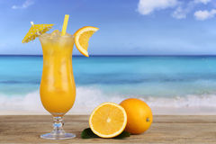 Orange juice fruit cocktail on the beach Stock Photo