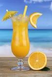 Orange juice fruit drink on the beach stock photography