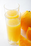 Orange juice with fruits Royalty Free Stock Image