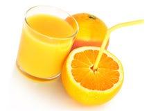 Orange juice. With orange fruits Royalty Free Stock Photo