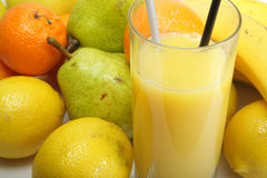 Orange juice and fruits. Orang juice and fruits in bulk Royalty Free Stock Image
