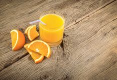 Orange juice in a glass. Citrus fruit drink stock photos