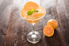 Orange juice in glass, fresh fruits on wooden background Royalty Free Stock Photography