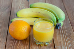 Orange juice in glass, fresh fruits on wooden Stock Photography